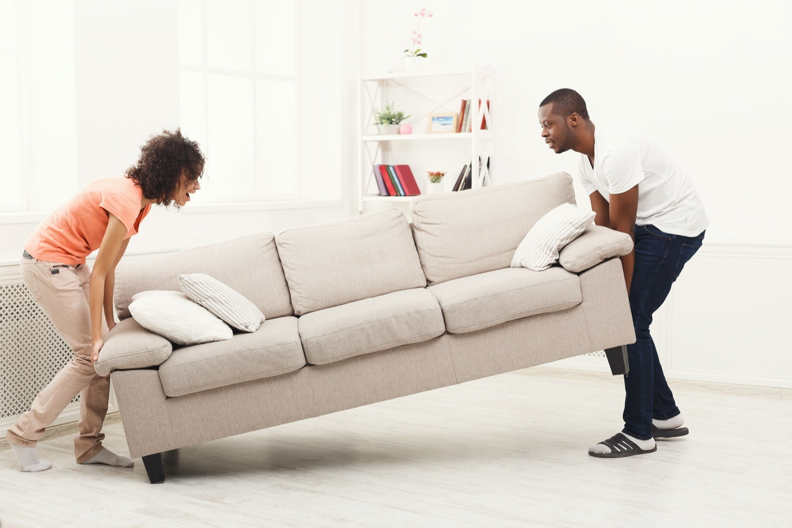 Couple moving couch | Gilman Floors