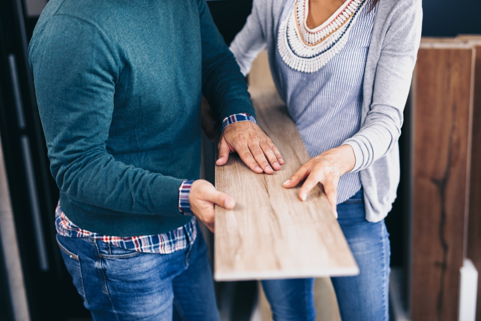 Man and woman talking about flooring | Gilman Floors