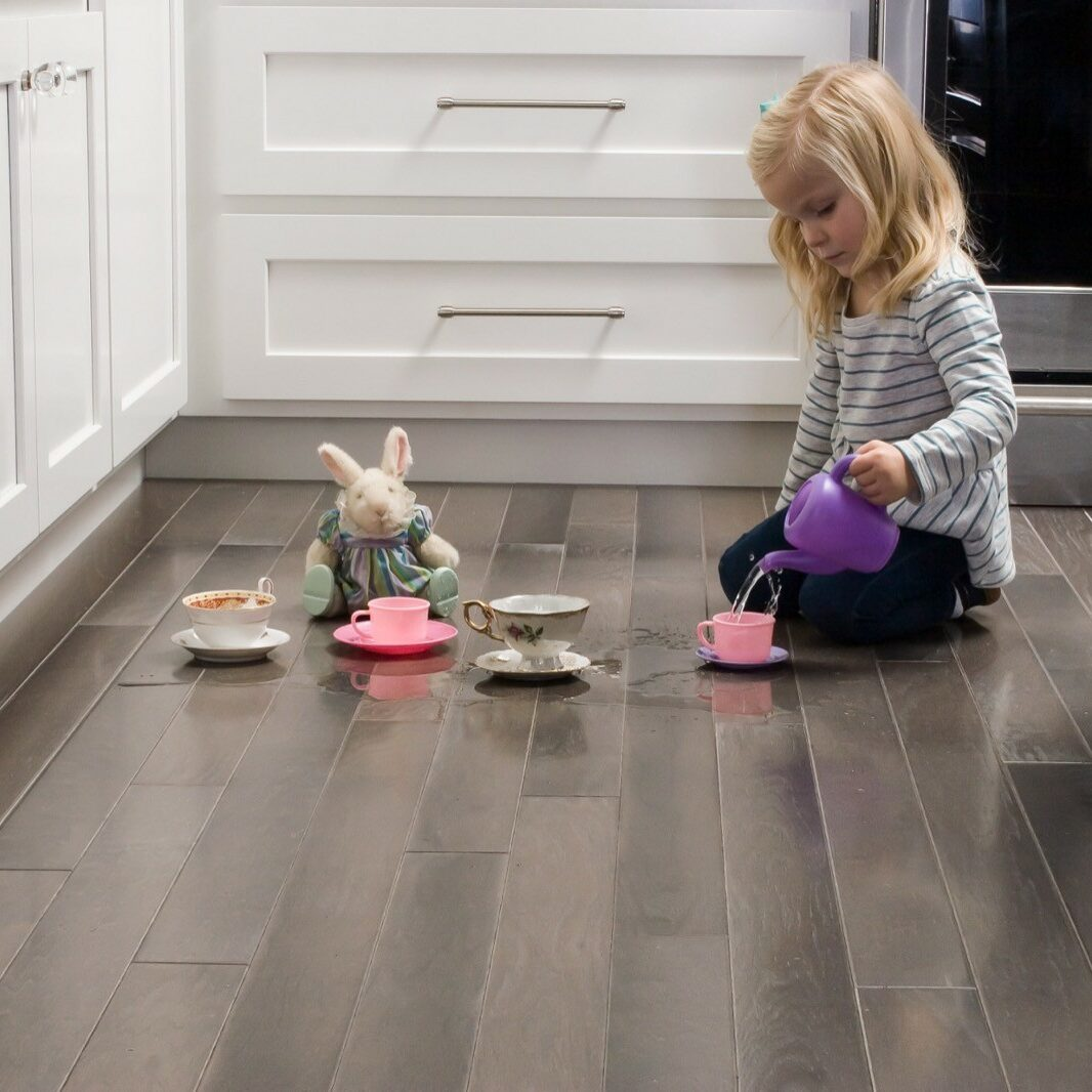child playing on luxury vinyl flooring in kitchen | Gilman Floors